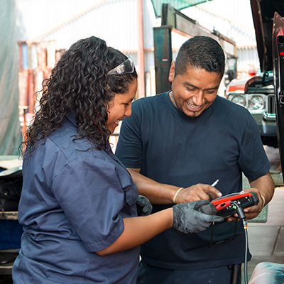woman and man working on car