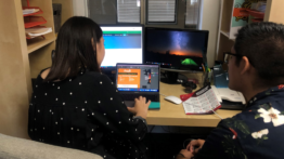 Interns at computer