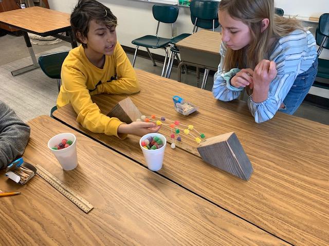kids playing at desk
