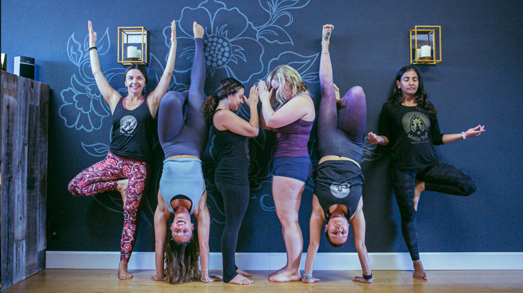 Yogis spelling yoga in poses