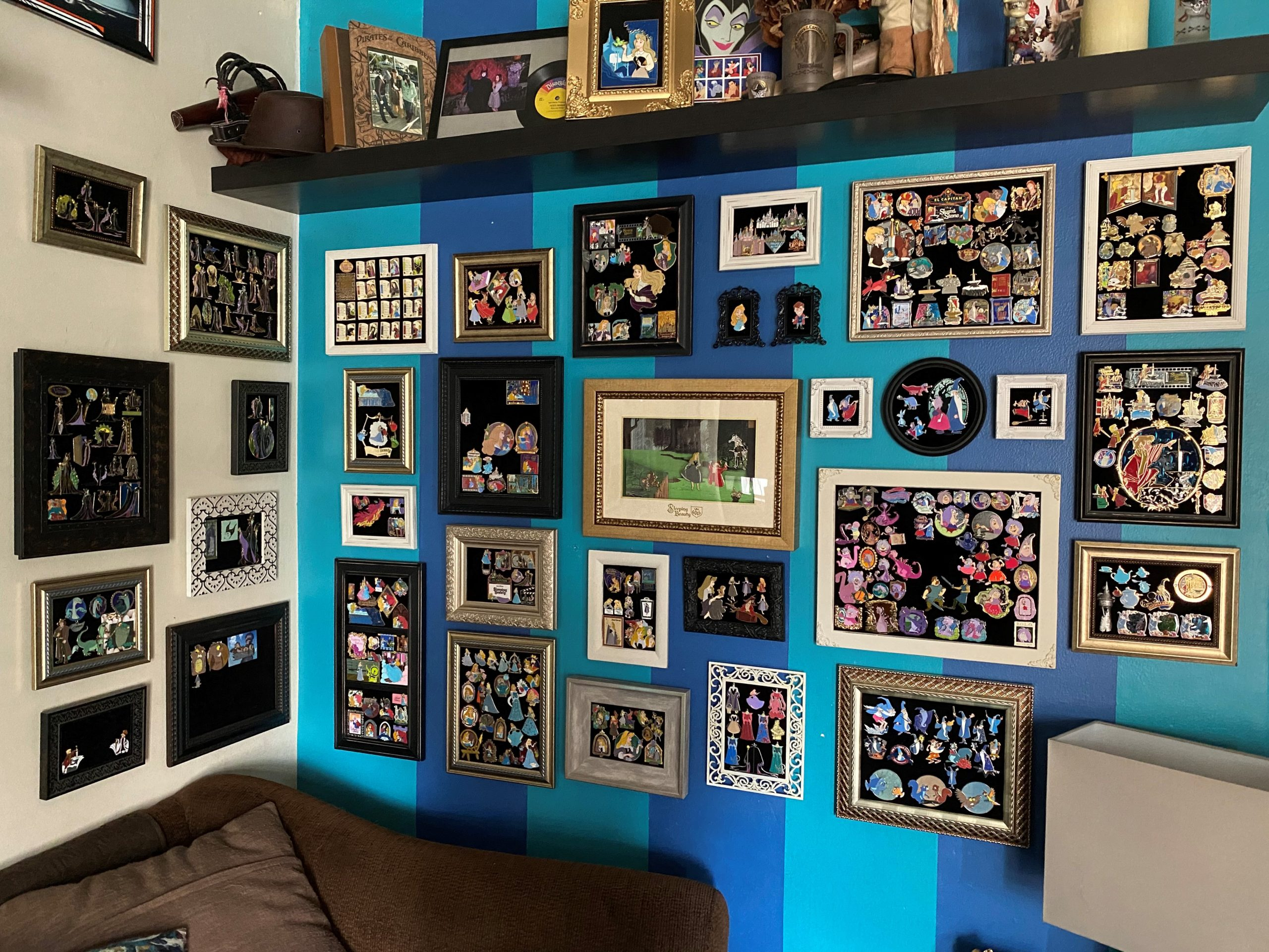 gallery of Disney pins on colorful wall