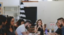 Business For Good members sitting around meeting table