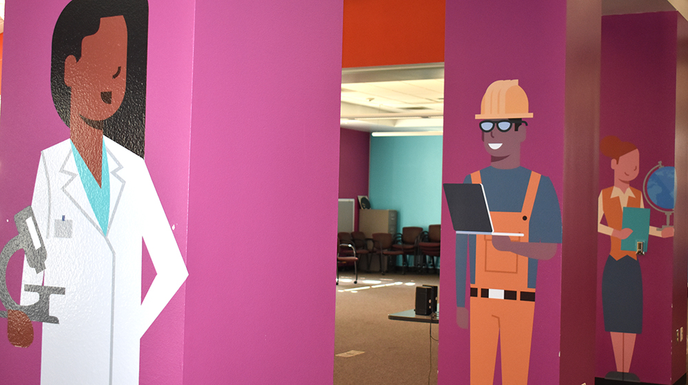 Illustrated images of people at work on columns in room