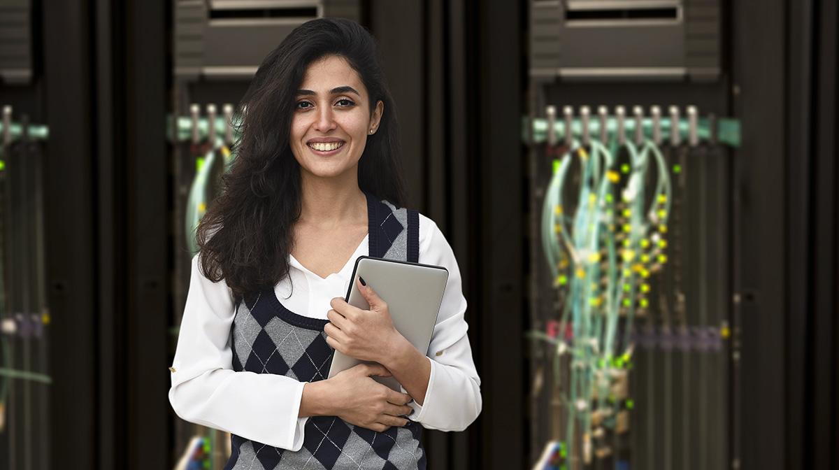 Female It Engineer In Server Room
